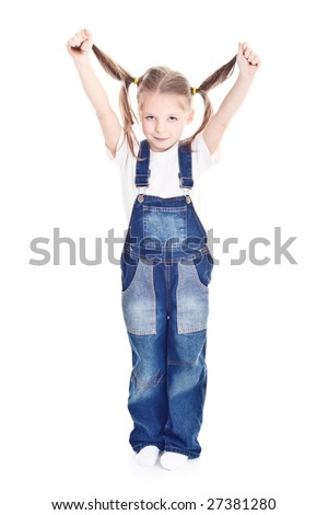 little girl in blue overalls holding her ponytails up