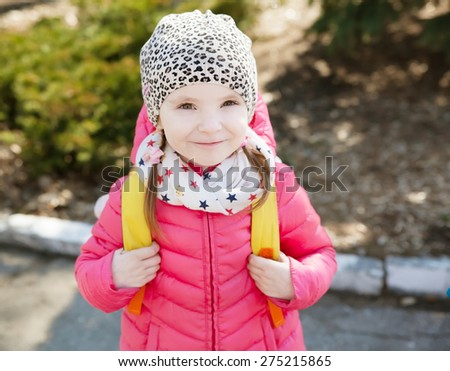 Little girl in bright clothes, spring season - stock photo