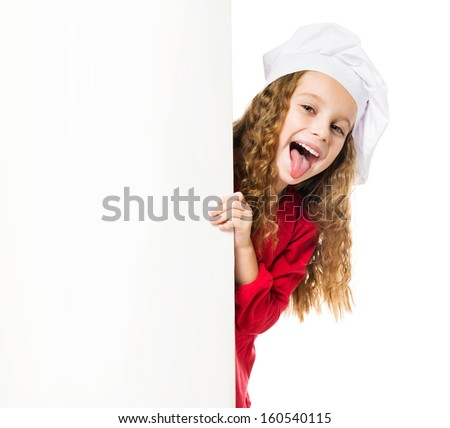 little girl in chef hat with a white board shows tongue - stock photo