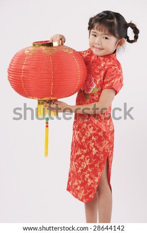 little girl in chinese traditional dress with lantern - stock photo