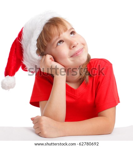 Little girl in christmas hat thinking - stock photo