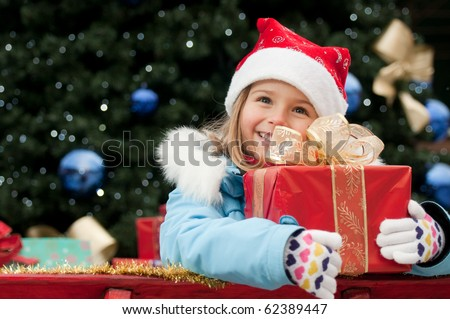 Little girl in Christmas sledge - stock photo