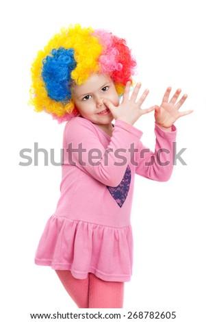 little girl in clown wig - stock photo