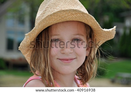 little girl in cowboy hat - stock photo