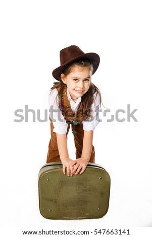 little girl in cowboy outfit on white background