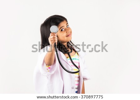 little girl in doctor uniform, asian girl wearing doctor's dress, indian little girl doctor, cute indian doctor, small doctor, isolated on white - stock photo