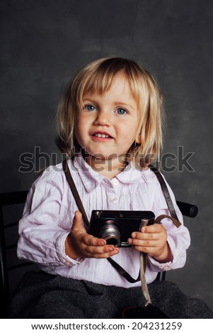 Little girl in dress and hat photographs