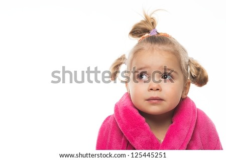 Little girl in dressing gown - stock photo