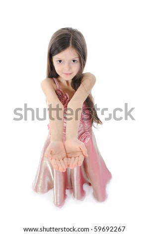little girl in evening dress. Isolated on white background - stock photo