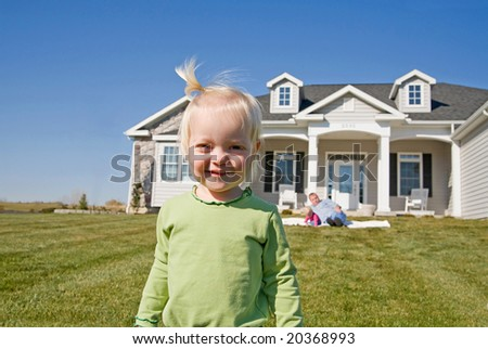 Little Girl in Front of Home - stock photo