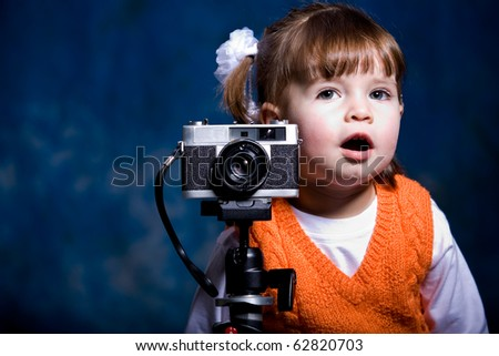 little girl in front of orange background