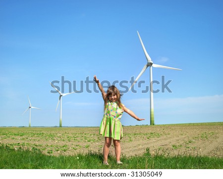 Little girl in front of windmills - stock photo
