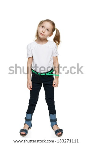 Little girl in full length looking up at blank copy space, isolated on white background - stock photo