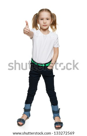 Little girl in full length making thumb up gesture, isolated on white background - stock photo