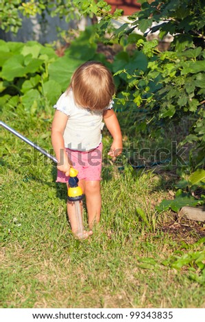 little girl in garden are pouring to water