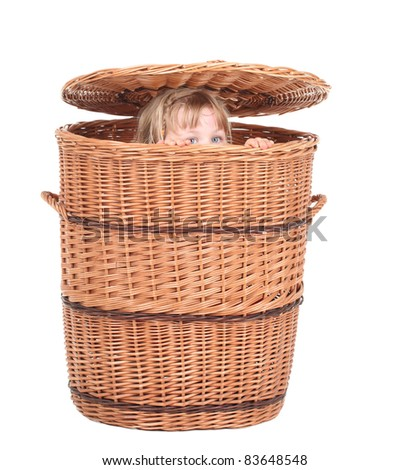 little girl in great wicker container with cover - stock photo