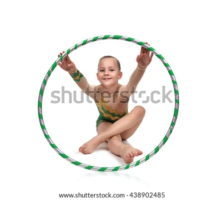 Little girl in green clothes with hula hoop doing gymnastics - stock photo