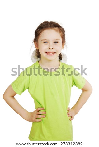 Little girl in green t-shirt stands and smiling - stock photo