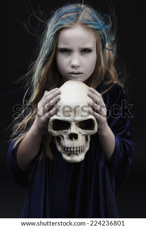 Little girl in halloween costume of the witch with the bonce