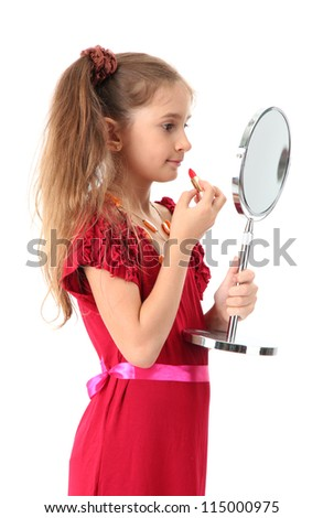 little girl in her mother's dress, is trying painting her lips, isolated on white