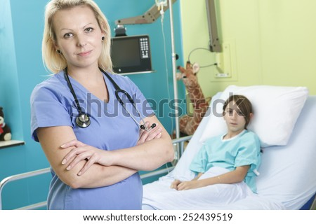 Little girl in hospital bed with the nurse - stock photo
