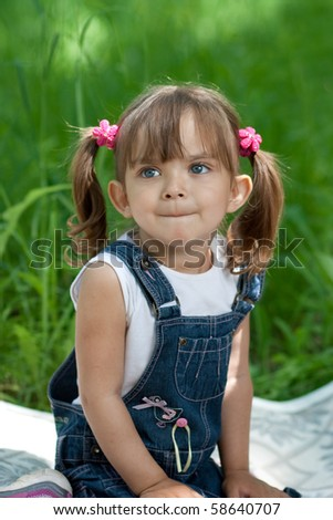 Little girl in jeans with blue eyes outdoor - stock photo