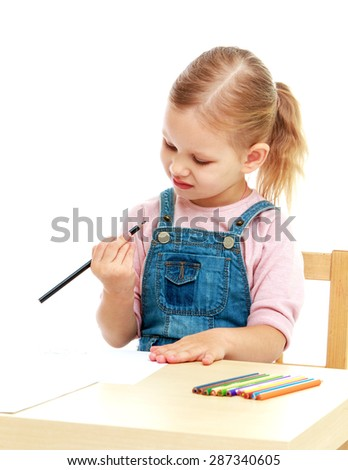 little girl in kindergarten is considering the pencil sitting on the table-isolated on white background