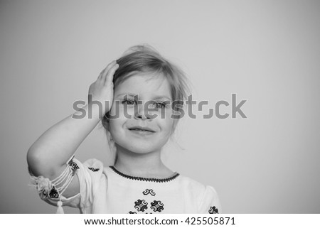 Little girl in national Ukrainian dress, embroidered shirt