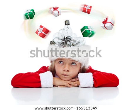 Little girl in need for a Christmas present idea - with lightbulbs in her santa hat - stock photo