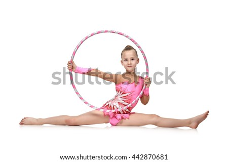 Little girl in pink clothes with hula hoop doing gymnastics, isolated on white - stock photo