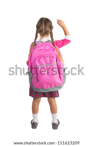 Little girl in pink school uniform with a backpack is writing imaginary message on white background, isolated - stock photo