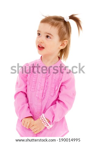 Little girl in pink shirt smiling and looking up