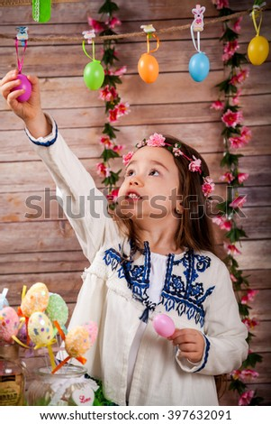 Little girl in popular Romanian costume enjoying the Easter holidays - stock photo