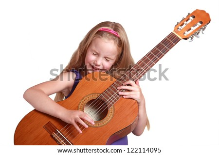 little girl in purple dress with spanish guitar and white background