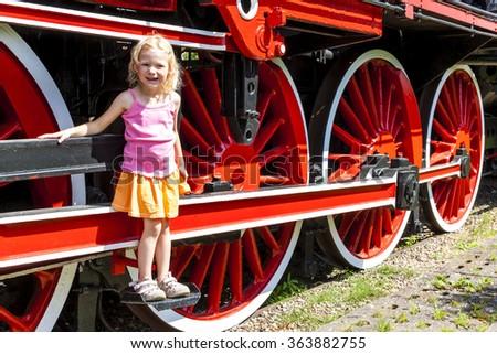 little girl in railway museum, Koscierzyna, Pomerania, Poland - stock photo