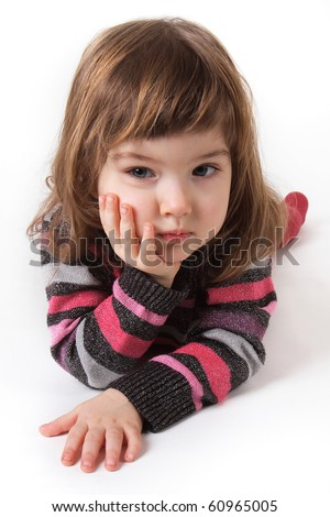 little girl in red tights and a bright dress on a white background - stock photo