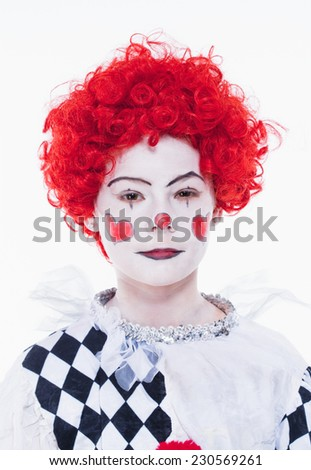 Little Girl in Red Wig, Makeup and Outfit Posing as a Clown. - stock photo