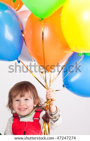 little girl in red with balloons - stock photo
