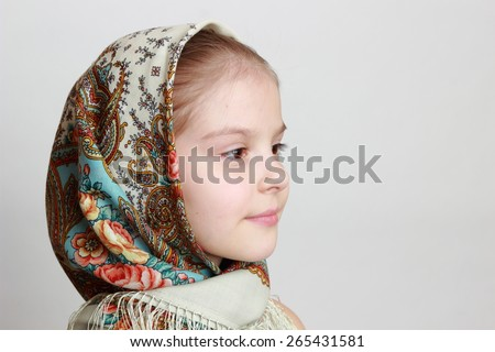 little girl in russian traditional Pavloposadskij scarf - stock photo