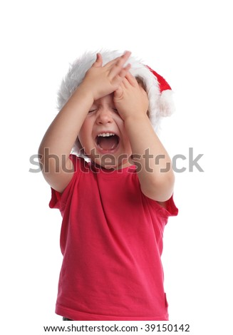 Little girl in santa hat isolated on white