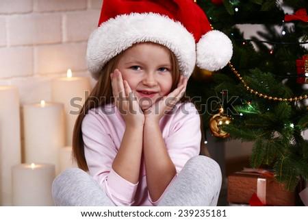 little girl santa hat sitting near stock photo edit now 239235181