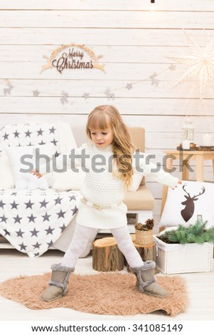 Little girl in scandinavian style christmas decorations