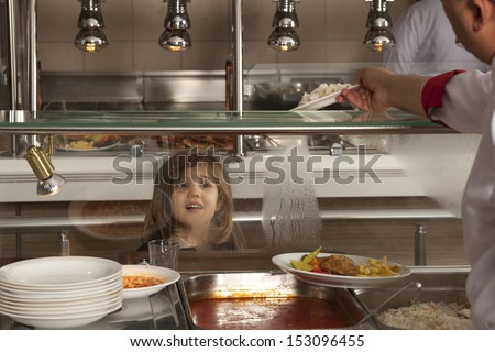 little girl in school cafeteria waiting lunch