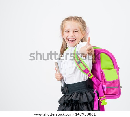 little girl in school uniform with backpack  isolated on white background - stock photo