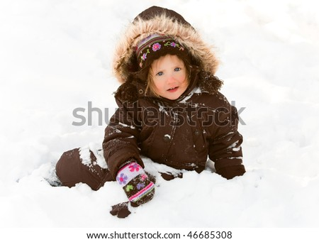 Little Girl in Snow - stock photo