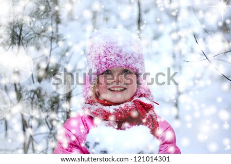 Little girl in snow forest. - stock photo