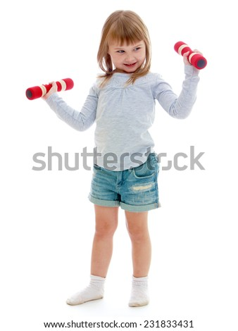 Little girl in sportswear holding a dumbbell. Happy childhood, fashion, autumnal mood concept. Isolated on white background - stock photo