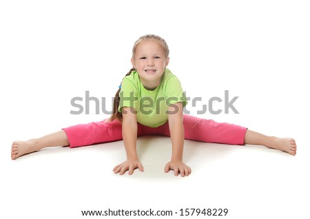 Little girl in sportswear isolated on white - stock photo