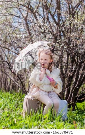 Little Girl in spring garden - stock photo