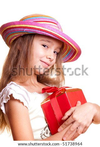 Little girl in straw hat holding gift boxes in hand - stock photo